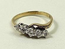 An 18ct gold and diamond crossover ring