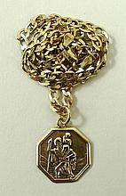 A 9ct gold octagonal medallion of St Christopher