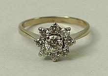 An 18ct gold and diamond flower head ring
