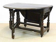 A 19th century drop leaf oval oak table