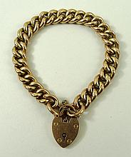 A 9ct gold link bracelet with pad lock clasp and safety chain