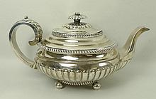 A Scottish early 19th century silver teapot of squat form