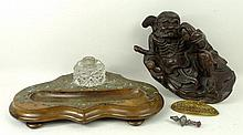 A Victorian walnut and brass bound inkwell stand, 33 by 23cm, a hardwood Indonesian carving of a rec