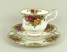 A Royal Albert porcelain tea service decorated in the 'Old Country Roses' pattern, comprising; twelv