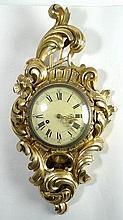 A Swedish giltwood wall clock, the circular enamel dial bearing Roman numerals, eight day movement,