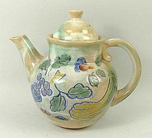 A Royal Doulton pottery part tea service, designed by Frank Brangwyn RA, polychrome decorated with f