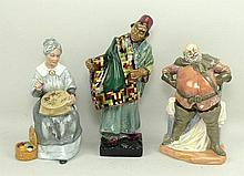 A group of three Royal Doulton figures, comprising The Carpet Seller, HN1464, Embroidering, H2855, a