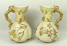 A pair of Royal Worcester blush ivory jugs, shape 1507, decorated with sprigs of spring flowers, the
