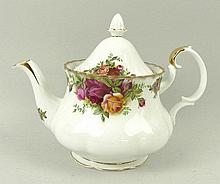 A Royal Albert porcelain part tea service decorated in the 'Country Roses' pattern, comprising; tea
