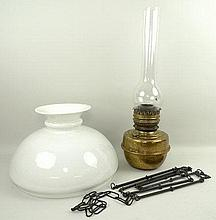 A Johnson Burton & Theobald brass oil lantern with glass funnel, 55cm, opaque shade, 36 by 23cm, and
