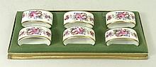 A set of six Royal Crown Derby porcelain napkin rings decorated in the 'Derby Posies' pattern, boxed