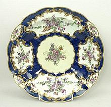 A Worcester, First Period, fluted dish reserve decorated with panels of flowers against a blue scale