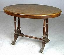 A Victorian burr walnut table, with marquetry decoration, the oval top above turned legs and single