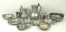 A quantity of pewter including a triform inkwell and cover, three pewter quaiches, a pewter dish bea