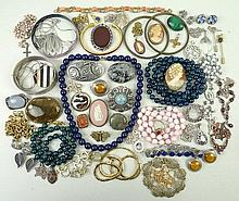 A quantity of silver and costume jewellery including hardstone set brooches, pendants, beads and ban