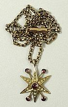 A 9ct gold, garnet and seed pearl star burst pendant on a 9ct gold kerb link chain, 5.7g.