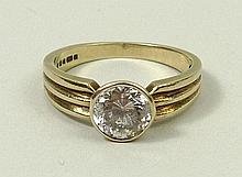 A 9ct gold and zircon set solitaire ring, size O, 3.2g.