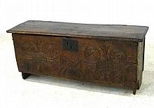 An oak blanket box, late 17th century, with a foliate carved front frieze, 98 by 33 by 40cm high.