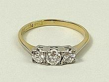 An 18ct gold, platinum and diamond three stone ring, approximately 0.375ct, size N, 2.4g.