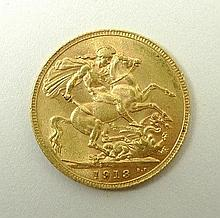 A George V gold sovereign 1913.
