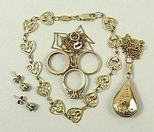 A quantity of gold jewellery comprising; a 14ct gold heart link bracelet, 4.5g, a 9ct gold tear drop