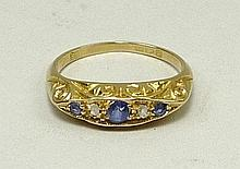 An 18ct gold, sapphire and diamond five stone ring, size M, 3.2g.