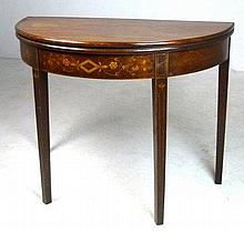 A George II mahogany demi lune tea table, with marquetry frieze displaying scrolling vine and flower