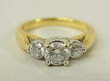 An 18ct gold, platinum and three stone diamond ring in a stepped design, approximately 0.7ct total,
