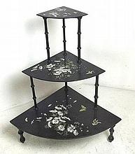 A black lacquered Japanese three tier set of graduated shelves, 70 by 50 by 81cm high.