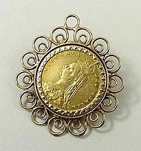 A Victorian half sovereign, date obscured, in a 9ct gold scrolling pendant mount, 8.9g.
