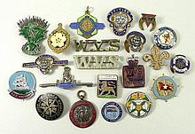 A quantity of badges and lapel pins including a Primrose League Badge bearing the motto Imperium Et