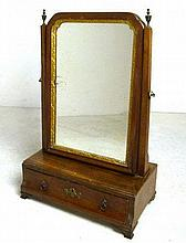 A George III walnut swing mirror with giltwood slip, with a concave single drawer, 34 by 19 by 51cm