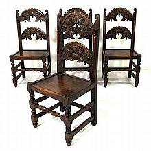A set of four stained oak chairs, early Yorkshire / Derbyshire style, with carved rails and splats,