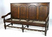 A late 17th century oak long settle, 185 by 110 by 67cm.
