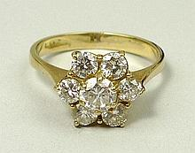 An 18ct gold and diamond seven stone flower head ring, diamonds approximately 1.1ct, size L, 3.2g.