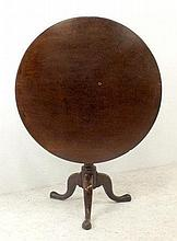 A George III mahogany tilt top occasional table, with birdcage action, turned baluster column raised