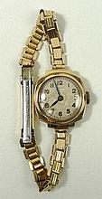 A Mimo lady's 9ct gold cased wristwatch, circular dial bearing Arabic numerals, on a rolled gold str