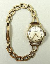 An Omega 9ct lady's wristwatch, silvered dial bearing Arabic numerals, fifteen jewel movement, no 10