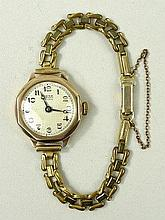 A 9ct gold Rone lady's wristwatch, silvered dial bearing Arabic numerals, on a plated strap.
