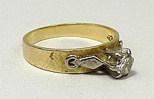 An 18ct gold and diamond solitaire ring, the 0.25ct diamond raised in a claw setting with white gold