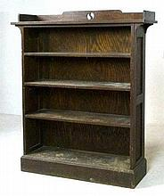 An Arts & Crafts oak bookcase with three shelves, 107 by 30 by 125cm high.
