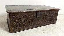 An 18th century oak bible box with a lunette carved foliate frieze, 64 by 39.5 by 22cm high.