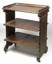 A 19th century mahogany three tier bookcase, with sides carved with columns with scroll capitals, 52