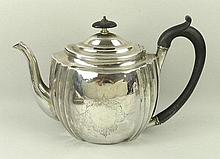 A George III silver tea pot of oval, vertical fluted form with reserve stipple engraved shield, Cris