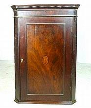 A 19th century mahogany corner cupboard with an inlaid oval shell motif to the door, 73 by 42 by 105
