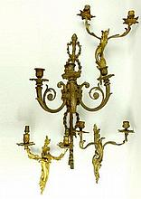 A group of gilt metal wall sconces, including a pair of twin branch sconces, 35cm high, a single ear
