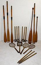 Two pairs of wooden rowing oars, two paddles, a pair of practise cricket wicket stumps, four wooden