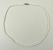 A cultured pearl single strand necklace on a 9ct gold clasp, 40cm long, boxed.