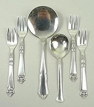 A set of four Danish silver pastry forks, designed by Poul Lutken Frigast, circa 1954, decorated in