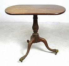 A 19th century mahogany tea table with rectangular top and tripod base, 84 by 60 by 73cm high.